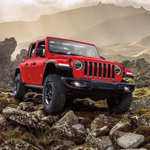 red jeep on mountainside